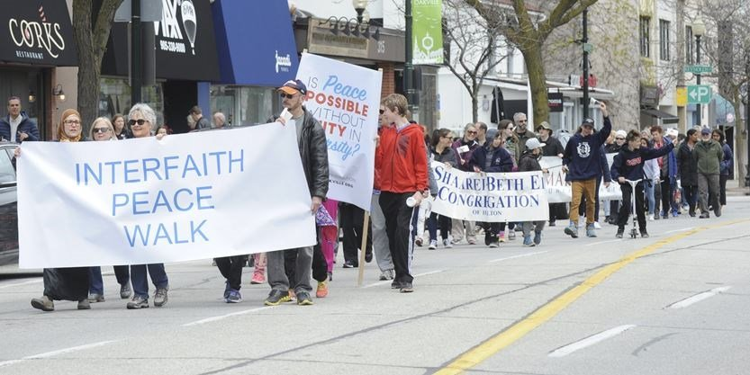 The annual Interfaith Peace Walk, right, made its way through downtown Oakville May 7
